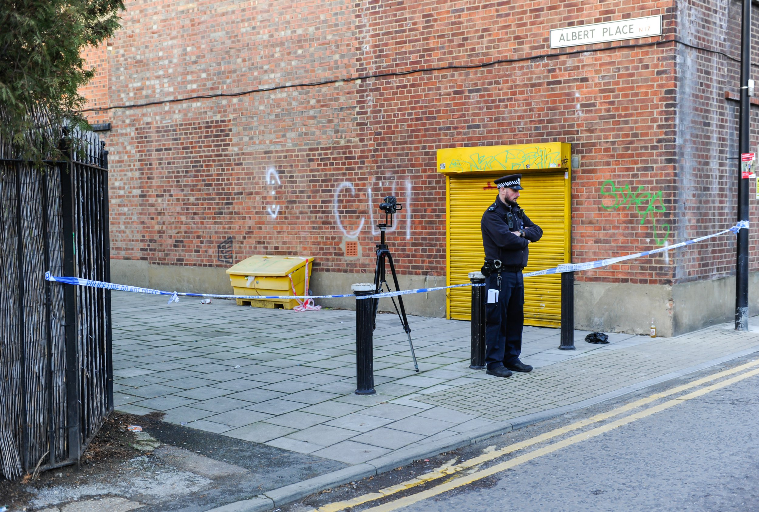 Image ??Licensed to i-Images Picture Agency. 22/12/2018. London, United Kingdom. Tottenham stabbing. A police cordon can still be seen at the crime scene. A young man has been stabbed to dead in an alleyway off a busy high street in north London. Emergency services were scrambled to Albert Place, off Tottenham High Road, at 1:20 am on Saturday. The victim was pronounced dead in hospital. Picture by Gustavo Valiente / i-Images