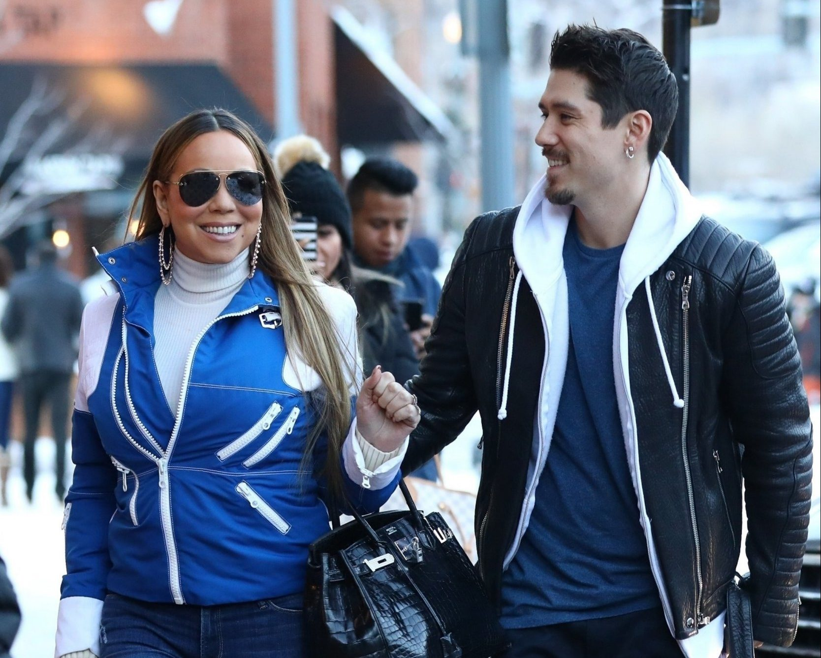 Aspen, CO - Superstar singer, Mariah Carey, and dancer boyfriend, Bryan Tanaka have had their fair share of shopping while out in Aspen for the holidays. The couple paid a visit to the Gucci store and were spotted with smiles that they carried all the way into the store. Pictured: Mariah Carey, Bryan Tanaka BACKGRID USA 22 DECEMBER 2018 USA: +1 310 798 9111 / usasales@backgrid.com UK: +44 208 344 2007 / uksales@backgrid.com *UK Clients - Pictures Containing Children Please Pixelate Face Prior To Publication*