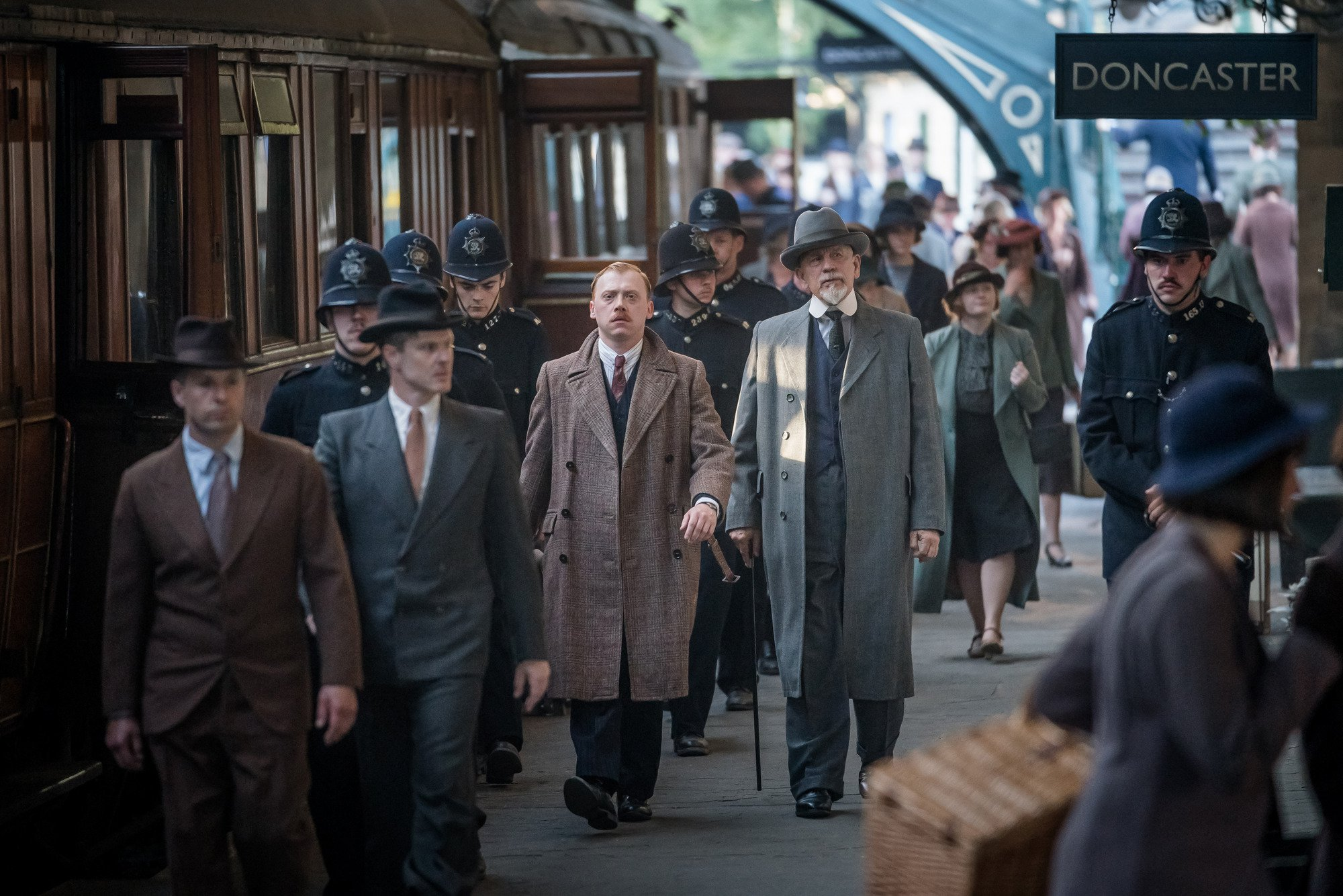 WARNING: Embargoed for publication until 00:00:01 on 11/12/2018 - Programme Name: The ABC Murders - TX: n/a - Episode: n/a (No. 2) - Picture Shows: Inspector Crome (RUPERT GRINT), Hercule Poirot (JOHN MALKOVICH) - (C) Mammoth Screen/Agatha Christie Ltd - Photographer: Ben Blackall