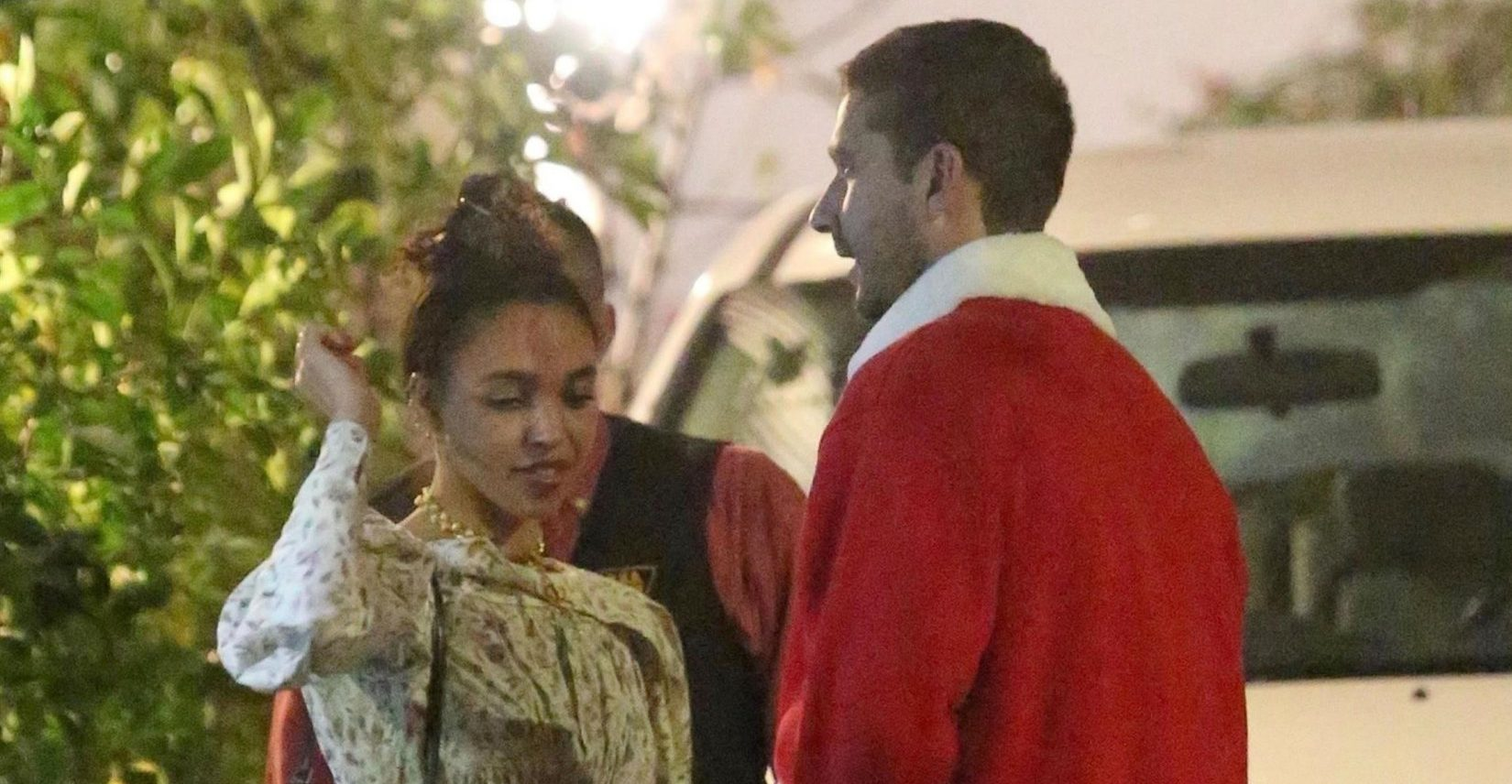 Los Feliz, CA - *EXCLUSIVE* - Actor Shia LaBeouf and his girlfriend FKA twigs were spotted wearing some very traditional holiday garb while out for a Christmas Eve dinner in Los Feliz. Pictured: Shia LaBeouf, FKA twigs BACKGRID USA 24 DECEMBER 2018 USA: +1 310 798 9111 / usasales@backgrid.com UK: +44 208 344 2007 / uksales@backgrid.com *UK Clients - Pictures Containing Children Please Pixelate Face Prior To Publication*
