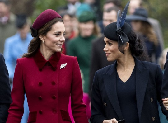 KING'S LYNN, ENGLAND - DECEMBER 25: Catherine, Duchess of Cambridge and Meghan, Duchess of Sussex attend Christmas Day Church service at Church of St Mary Magdalene on the Sandringham estate on December 25, 2018 in King's Lynn, England. (Photo by Mark Cuthbert/UK Press via Getty Images)