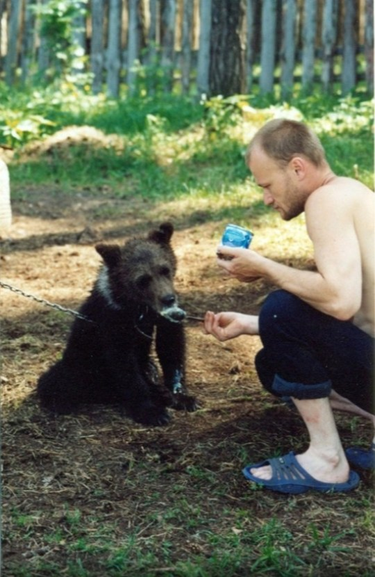 Sergey Grigoriyev with his bear when it was a cub