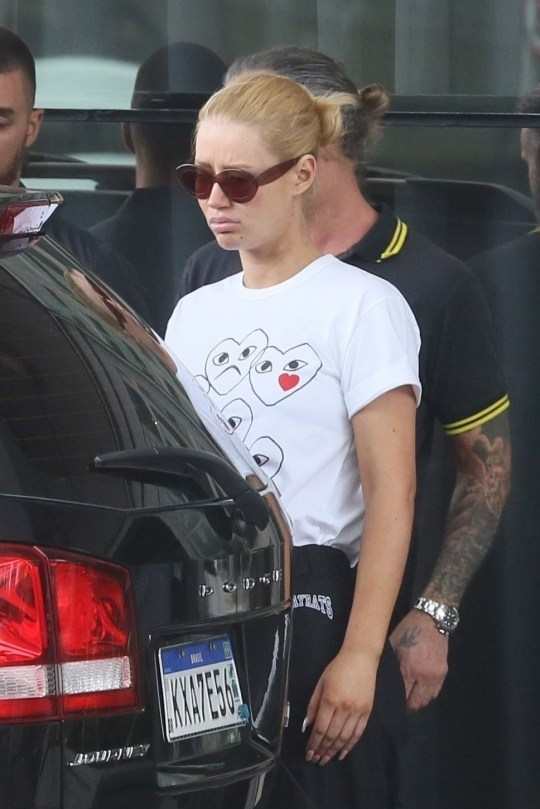** RIGHTS: WORLDWIDE EXCEPT IN BRAZIL ** Rio de Janeiro, BRAZIL - *EXCLUSIVE* - Iggy Azalea looks upset as she leaves her hotel to go to dinner. Iggy looks casual but trendy in sunglasses, a white t-shirt, black Strayrats sweatpants, and black sneakers as she makes her way to her car pouting. Pictured: Iggy Azalea BACKGRID USA 27 DECEMBER 2018 BYLINE MUST READ: GADE / BACKGRID USA: +1 310 798 9111 / usasales@backgrid.com UK: +44 208 344 2007 / uksales@backgrid.com *UK Clients - Pictures Containing Children Please Pixelate Face Prior To Publication*