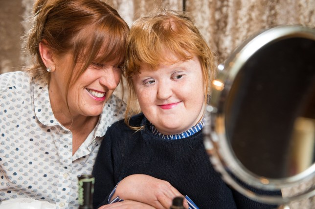 "Kira Yates, 13, who has Aperts Syndrome, is now able to wear makeup ,which she has requested for Christmas, and mum Michelle, 52, is helping her learn to apply it, pictured at home near Doncaster, North Lincs.See SWNS story SWLEmakeup . A teenager born resembling a ???broken doll??? has received makeup for the first time for Christmas - after having her face painstakingly rebuilt.Kira Yates, 13, suffers from a rare condition which meant she was born with malformations of the skull, face, hands and feet.However, four years after pioneering surgery where her skull was ""smashed and reshaped"", fashion-obsessed Kira asked to be bought makeup for the first time.Her proud mother Michelle, 52, said Kira, who ""used to get the mickey taken out of her looks"", has thrived since the series of major operations in 2014."