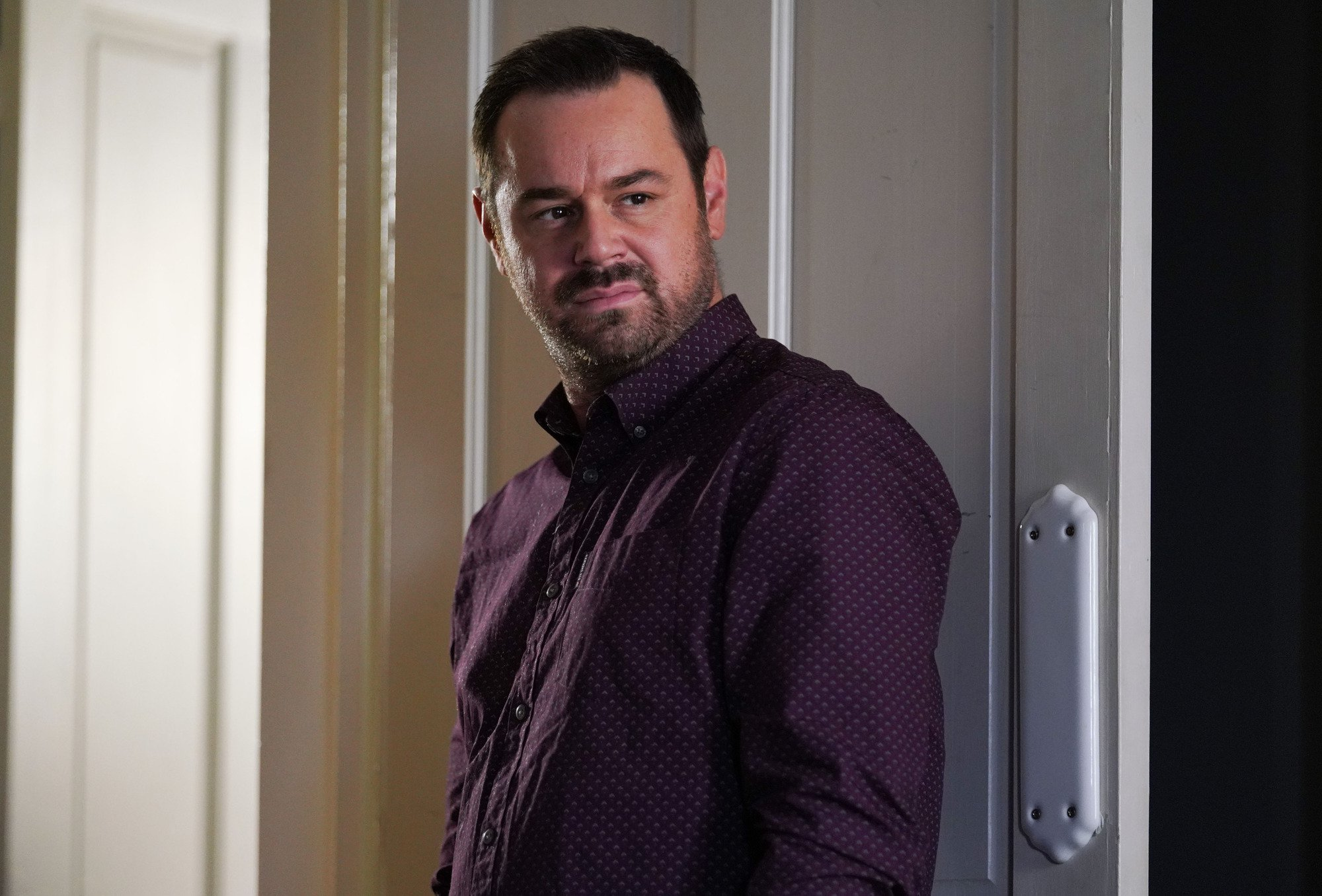 WARNING: Embargoed for publication until 00:00:01 on 08/01/2019 - Programme Name: EastEnders - January - March 2019 - TX: 17/01/2019 - Episode: EastEnders - January - March - 2019 - 5852 (No. 5852) - Picture Shows: *STRICTLY NOT FOR PUBLICATION UNTIL 00:01HRS TUESDAY 8th JANUARY 2019* Tensions are high between Mick and Linda Mick Carter (DANNY DYER) - (C) BBC - Photographer: Kieron McCarron