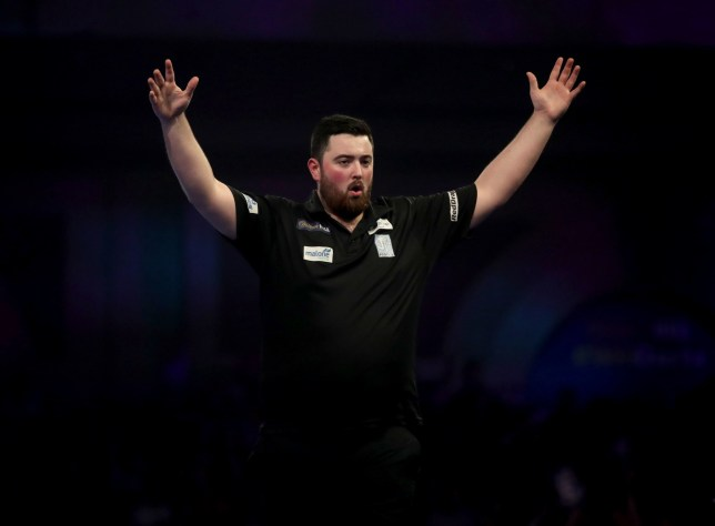 Luke Humphries celebrates his win during day thirteen of the William Hill World Darts Championships at Alexandra Palace, London. PRESS ASSOCIATION Photo. Picture date: Friday December 28, 2018. See PA story DARTS World. Photo credit should read: Adam Davy/PA Wire