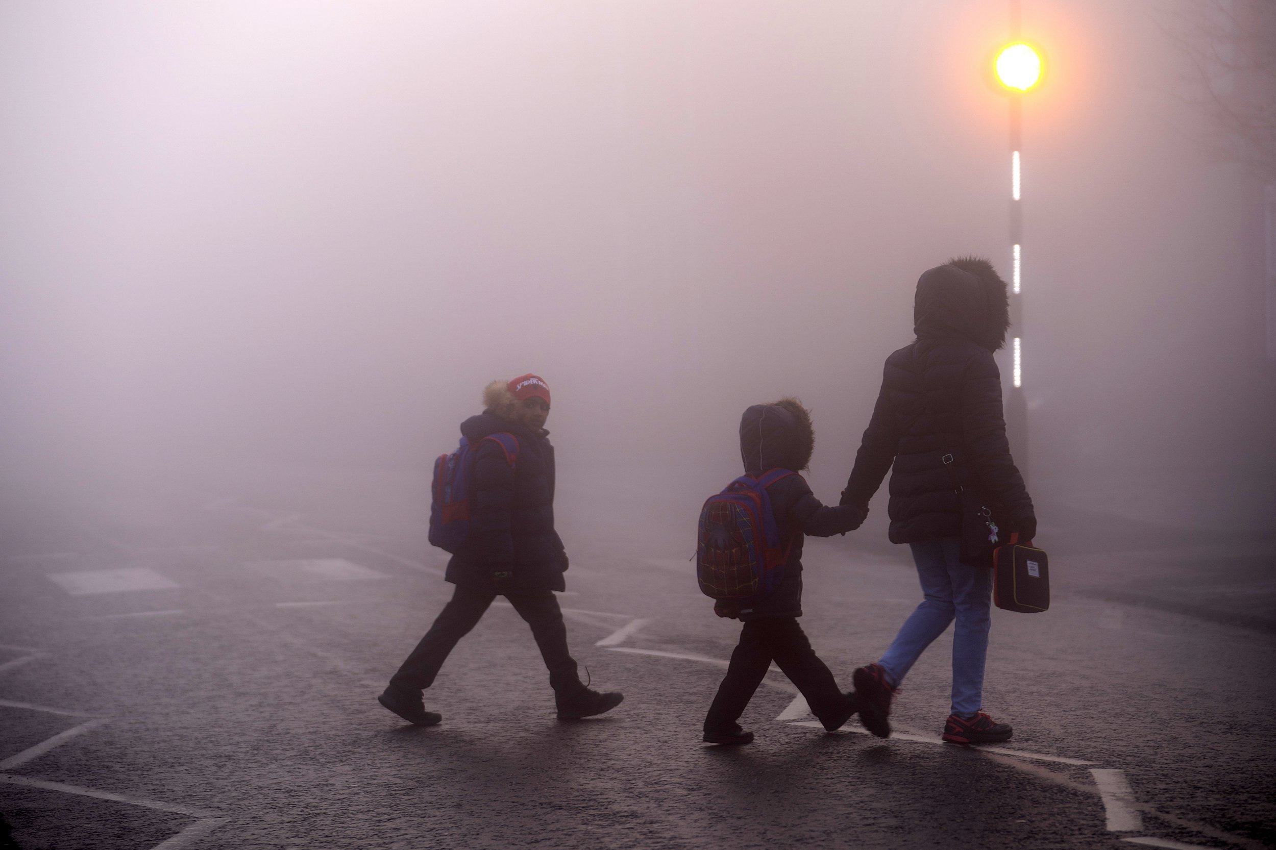 NORTHWICH, ENGLAND - DECEMBER 04: A family make their way to school as freezing temperatures create a cold and foggy start for parts of England and Wales on December 04, 2018 in Northwich, England. (Photo by Christopher Furlong/Getty Images)
