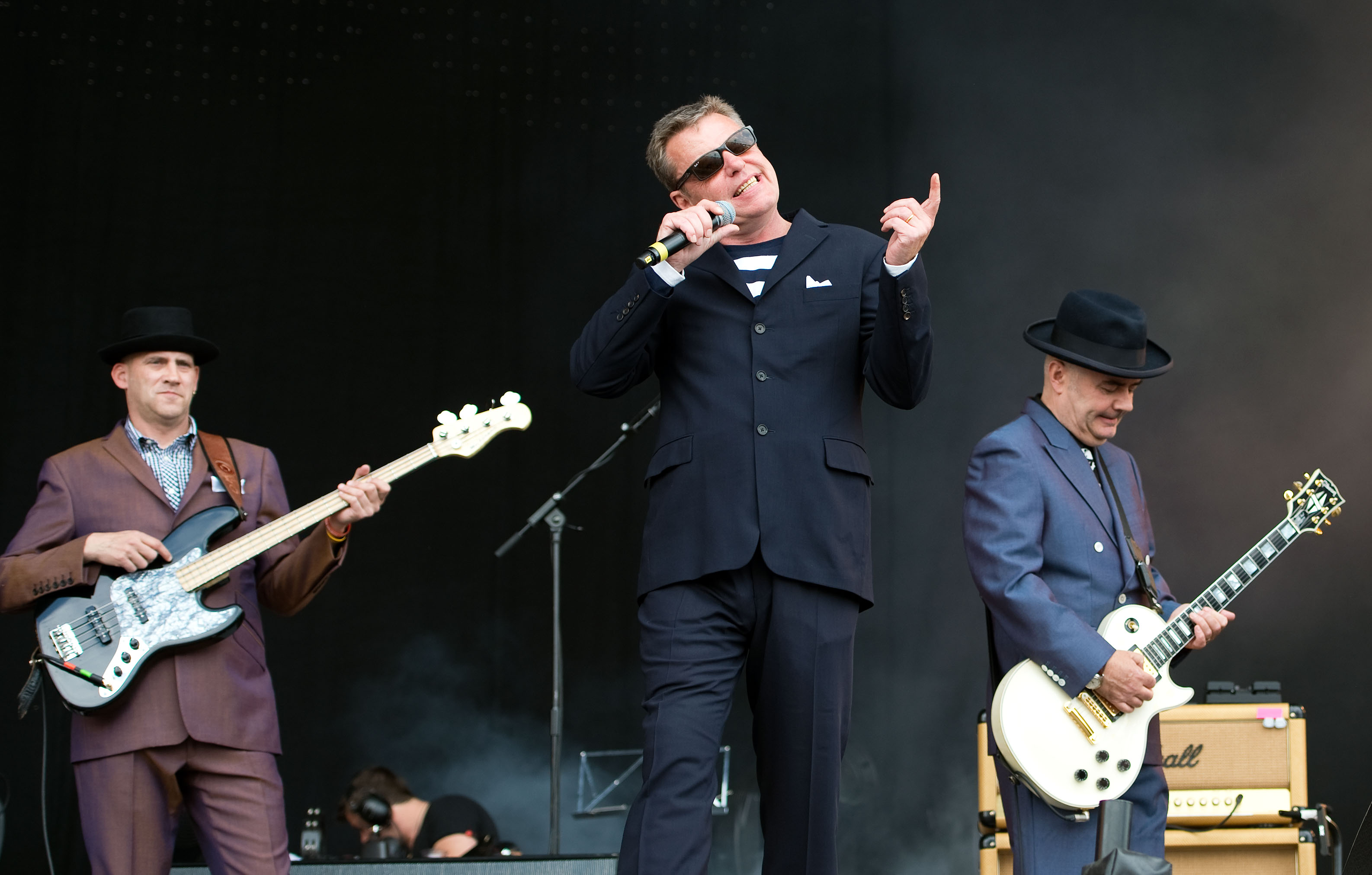 When did Madness form and which are their best-known hits as they bring in the New Year on BBC One?