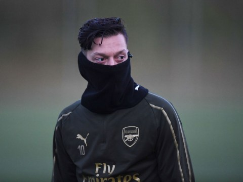 Gary Neville digs out injured Arsenal star Mesut Ozil during Tottenham clash
