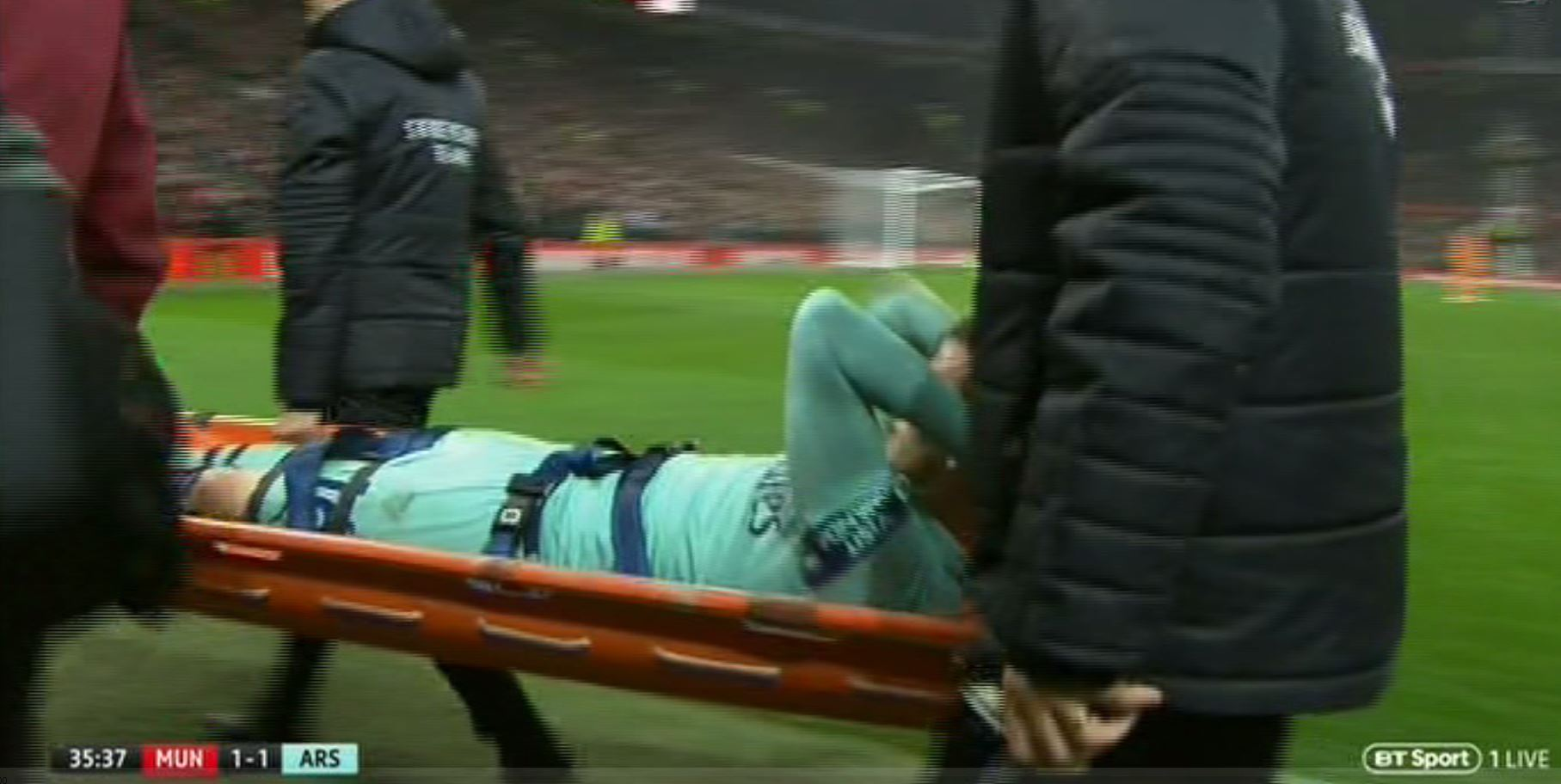 Rob Holding stretchered off in leg cast after challenge from Marcus Rashford