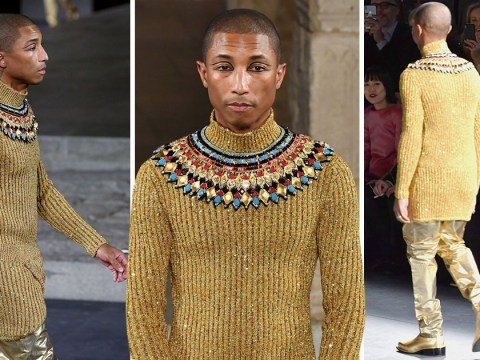 Pharrell Williams glitters in gold for Chanel as he walks in New York fashion show