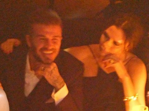 Victoria Beckham lovingly wraps her arm around David during awards dinner with Brooklyn
