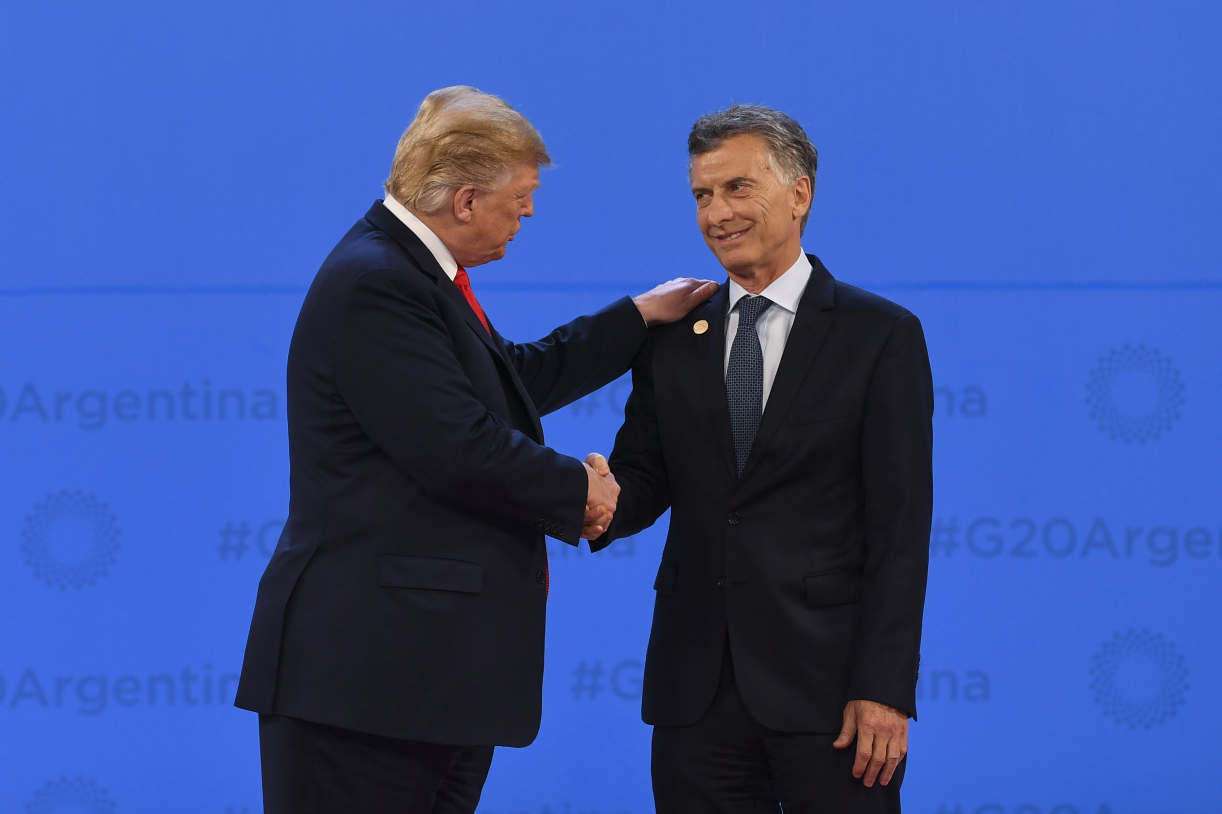 epa07200281 US President Donald Trump (left) is welcomed by the President of Argentina Mauricio Macri at the G20 summit in Buenos Aires, Argentina, 30 November 2018. The Group of Twenty (G20) Summit brings together the heads of State or Government of the 20 largest economies and takes place from 30 November to 01 December 2018. EPA/LUKAS COCH AUSTRALIA AND NEW ZEALAND OUT