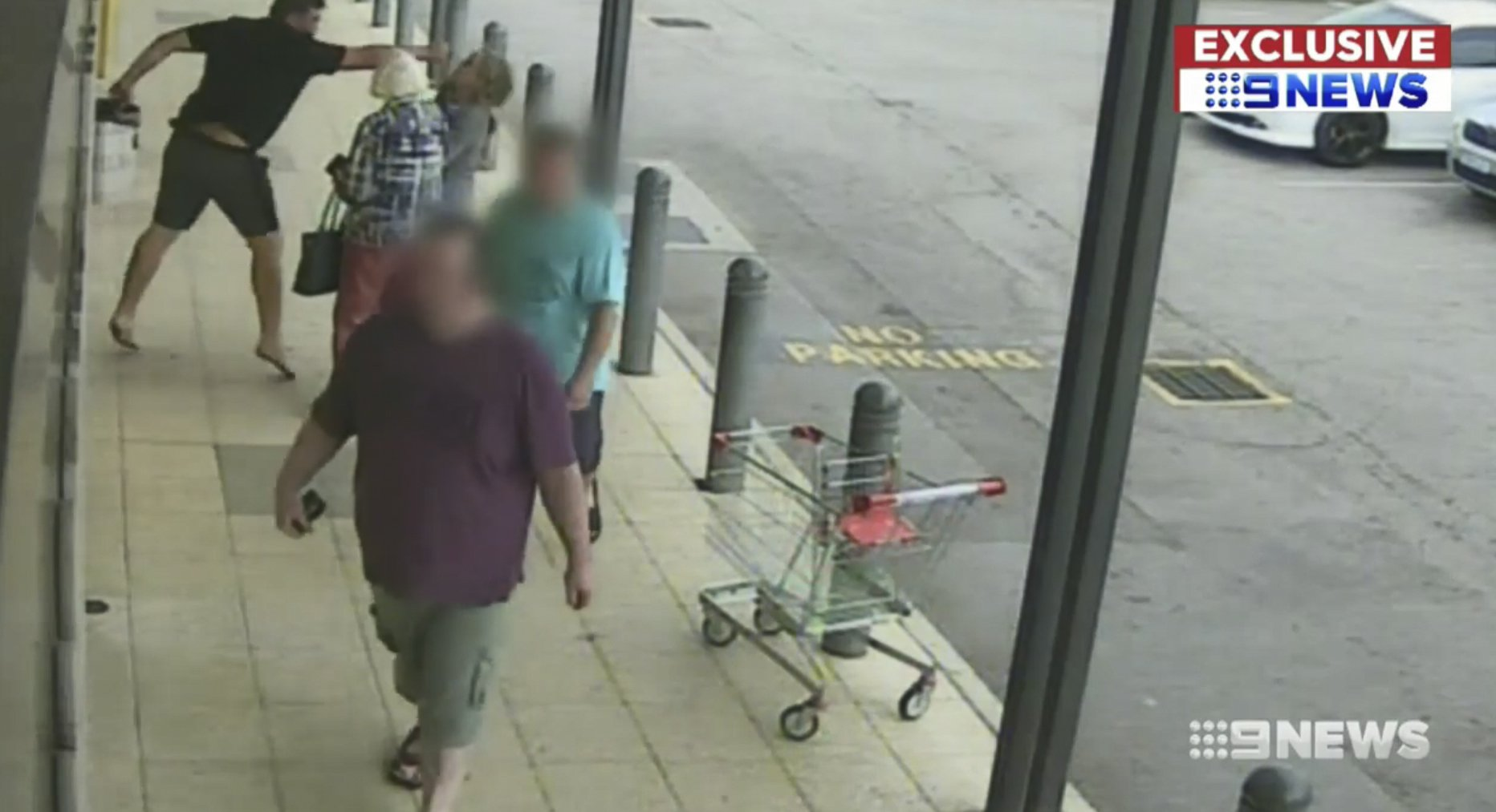 6448217 Shocking moment a 90-year-old grandmother is sent sprawling to the ground in a sickening attack as her granddaughter is sucker punched and fly-kicked by a thug