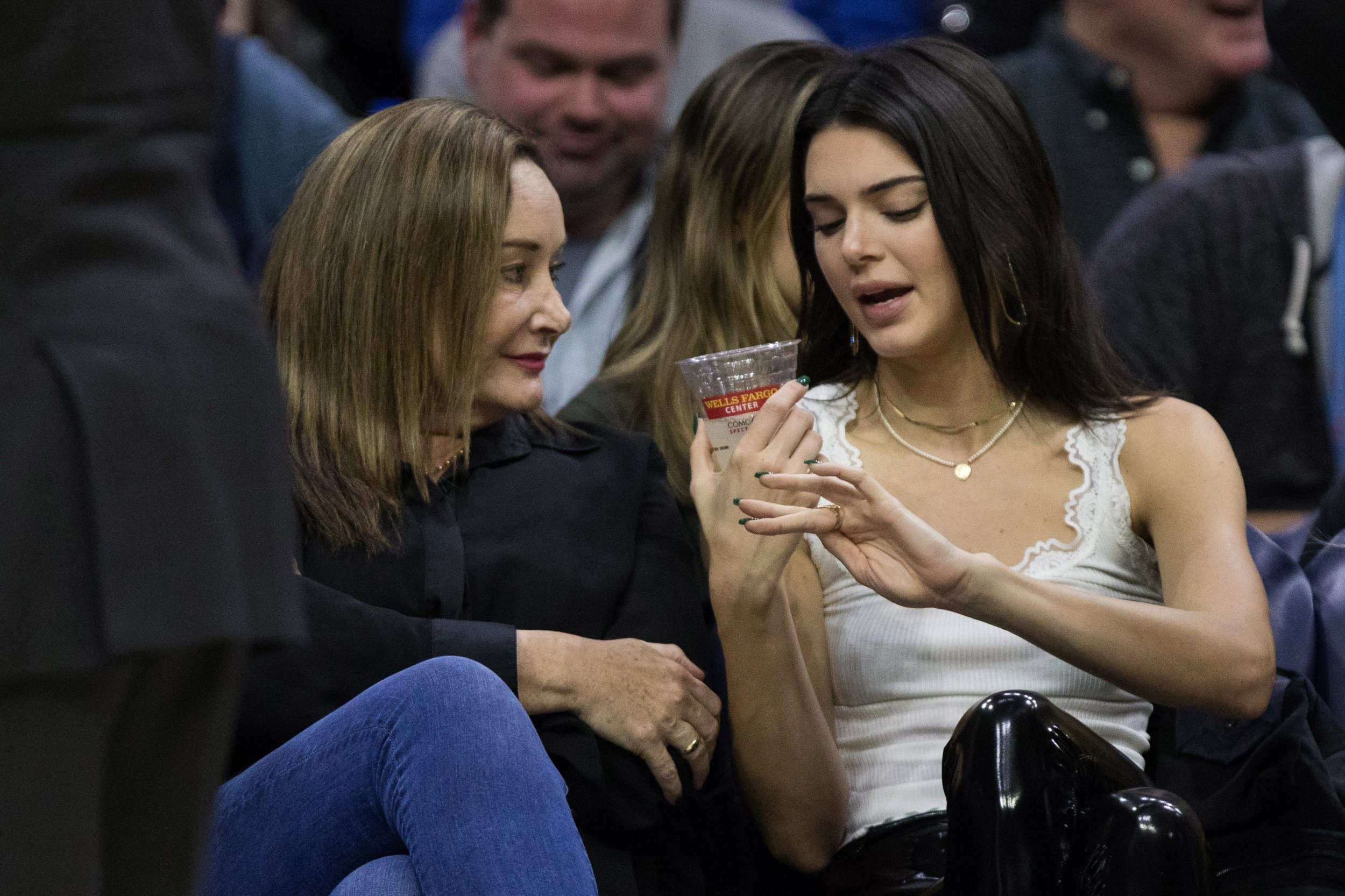 Nov 30, 2018; Philadelphia, PA, USA; Kendall Jenner (R) talks with Philadelphia 76ers guard Ben Simmons (not pictured) mother Julie Simmons (L) during the second quarter of a game against the Washington Wizards at Wells Fargo Center. Mandatory Credit: Bill Streicher-USA TODAY Sports