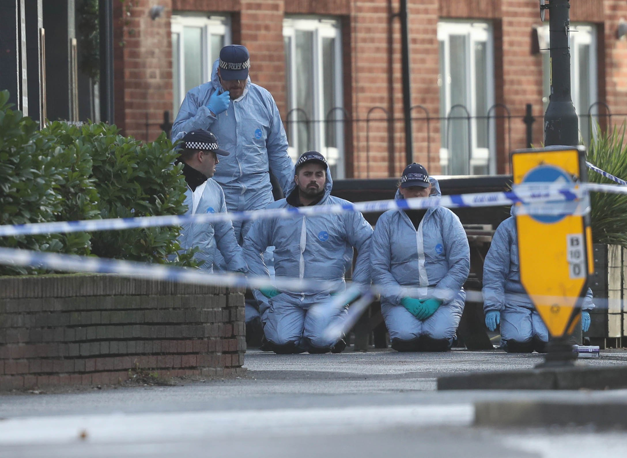 Police at the scene after a man was shot during a police operation in Wimbledon, south-west London. PRESS ASSOCIATION Photo. Picture date: Monday December 3, 2018. The Metropolitan Police said he was shot at around 8.10am on Monday in Lacock Close during an operation involving officers from the anti-robbery Flying Squad supported by armed colleagues. See PA story POLICE Wimbledon. Photo credit should read: Steve Parsons/PA Wire