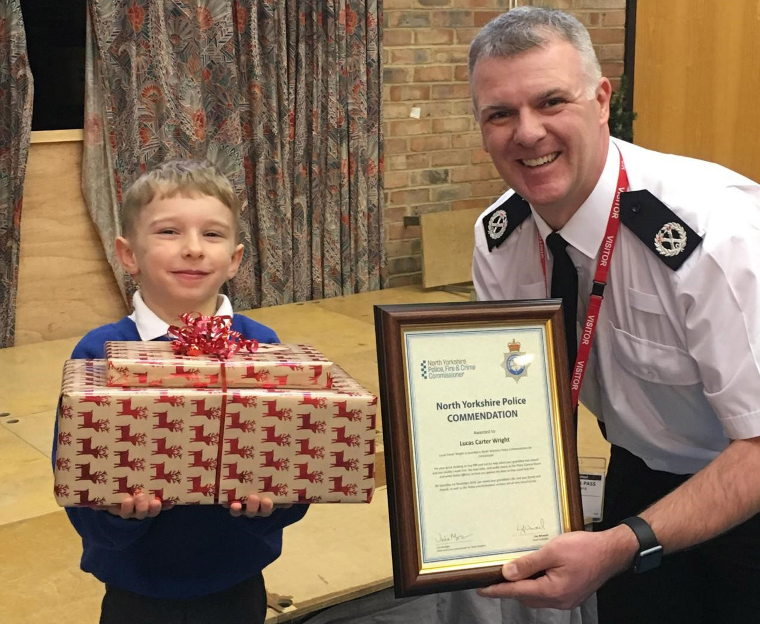 Undated handout photo issued by North Yorkshire Police of Lucas Carter Wright and ACC Ciaron Irvine, the five-year-old boy has been praised for calling 999 after his Grandad fell ill at his home in North Yorkshire. PRESS ASSOCIATION Photo. Issue date: Tuesday December 4, 2018. Lucas had been staying with his Grandad for the night but woke to find him unconscious on the sofa, Communications Officer Gabby Rudge-Cox, who handled Lucas? call, was able to retrieve enough information from him to determine his Grandad needed emergency services. See PA story HEALTH Lucas. Photo credit should read: North Yorkshire Police/PA Wire NOTE TO EDITORS: This handout photo may only be used in for editorial reporting purposes for the contemporaneous illustration of events, things or the people in the image or facts mentioned in the caption. Reuse of the picture may require further permission from the copyright holder.