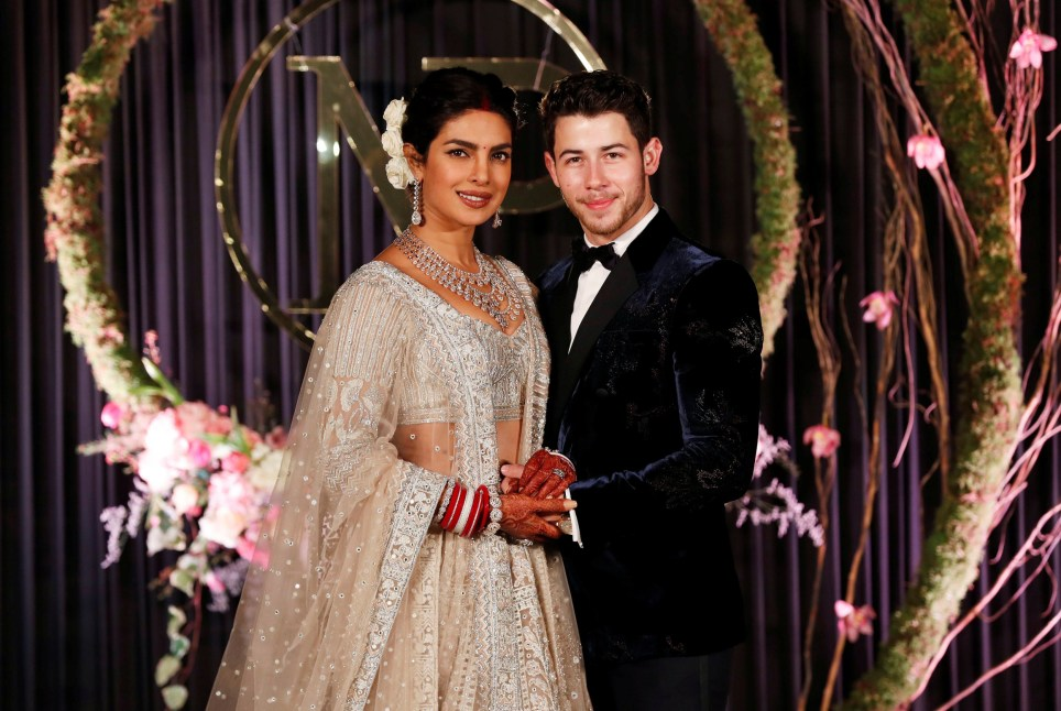 5b22f2f78a38e Bollywood actress Priyanka Chopra and her husband singer Nick Jonas pose  during a photo opportunity at