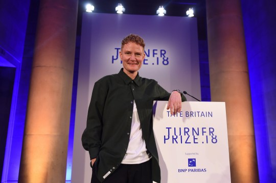 epa07208913 Artist Charlotte Prodger smiles after being announced as the winner of the 2018 Turner Prize at the Tate Britain in Central London, Britain, 04 December 2018. The Turner Prize, which is presented since 1984 to a British-born or based artist aged under 50, is in its 34th year and is considered the highest award for arts in Britain. EPA/ANDY RAIN
