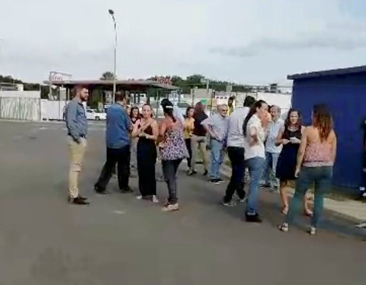 People gather outside during a quake evacuation in Noumea, New Caledonia December 5, 2018 in this still image taken from a video obtained from social media. Facebook/Jean Jacques Brunet/via REUTERS THIS IMAGE HAS BEEN SUPPLIED BY A THIRD PARTY. MANDATORY CREDIT. NO RESALES. NO ARCHIVES.