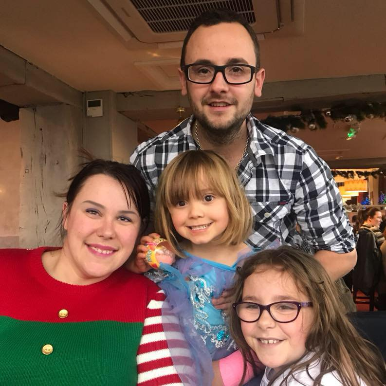 A young family have been left homeless after their new Christmas tree burst into flames - and destroyed their house as they slept. Nicola Jayne Jackson, 33, managed to flee the house with daughters Nia, nine, and Eva, six, when their fir tree caught fire. The family were lucky to get out alive - but their Christmas presents and belongings were destroyed only a few weeks before the big day. Pictured here is the Jackson family. Bradley, Nicola, Eva 6 & Nia 9. ? WALES NEWS SERVICE
