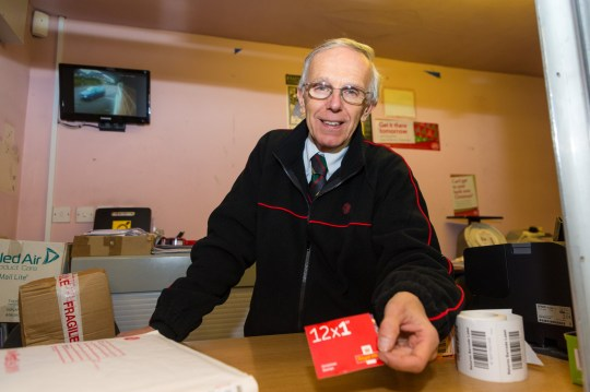 """Paul Bennett, 59, the Relief Sub Post Office Master at Stone Quarry Sub Post Office in East Grinstead, East Sussex has successfully faced down 14 robbery attempts over the years. East Grinstead, December 05 2018. See National News story NNpostie.Britain's bravest postie foiled his 14th robbery by laughing in the armed robbers' faces and telling them to """"p*ss off"""" - despite being faced with a SHOTGUN.Paul Bennett, 59, was working alone when a pair of would-be robbers threatened him with a shotgun.But the heroic dad-of-two surprised them after he told them to """"p*ss off"""" and watched as they gave up and left.Paul, from East Grinstead, West Sussex, who started working in his parents' Post Office when he was 15, has foiled 14 attempted robberies."""