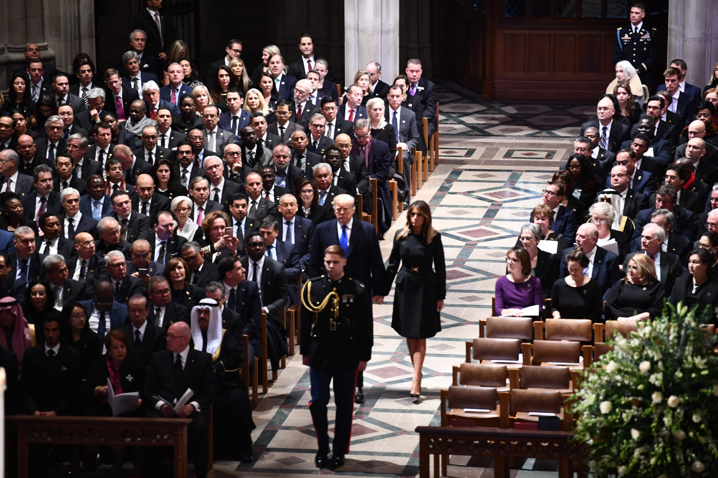 US President Donald Trump and First Lady Melania Trump arrive for the funeral service for former US president George H. W. Bush at the National Cathedral in Washington, DC on December 5, 2018. (Photo by AFP)/AFP/Getty Images