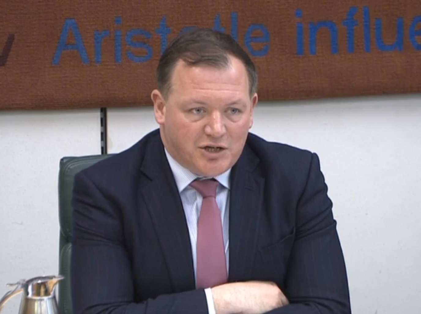 Damian Collins, chairman of the House of Commons Digital, Culture, Media and Sport Committee, speaks at a hearing in Portcullis House, London, where he repeated his call for Facebook founder Mark Zuckerberg to give evidence to the committee's inquiry into fake news.