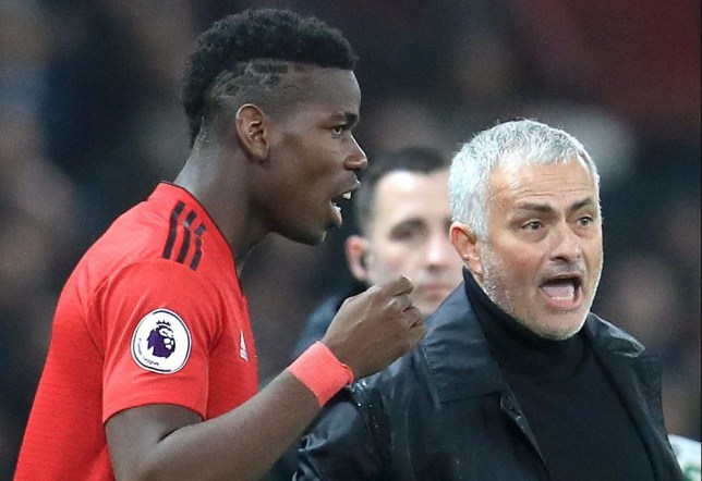 Manchester United's Paul Pogba (left) speaks with Manchester United manager Jose Mourinho