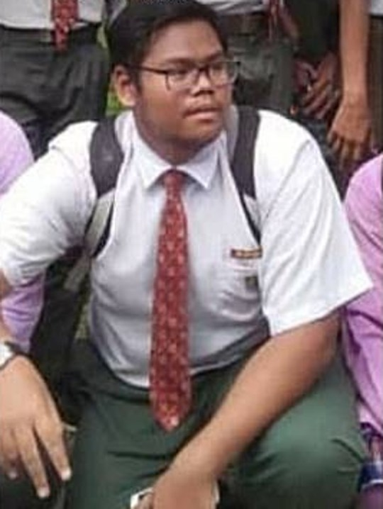 """Pic shows: Mohd. Aidil Azzahar Zaharin in school uniform These shocking pictures show a 16-year-old boy with blood pouring out of his blackened ears after he was electrocuted while using his headphones on his plugged-in phone. The incident occurred near the town of Rembau in the state of Negeri Sembilan in Malaysia, when the boy, identified as Mohammed Aidil Azzahar Zaharin, was wearing his headphones while sleeping. He was found the next day motionless and cold on the floor by his unnamed mother, 51, who thought he was asleep. She then tried to wake him up but unable to do so, she called medics who declared him dead. It was then confirmed that the boy did not have any other injuries or bruises on his body other than bleeding and burns on his left ear, and the autopsy later showed that the cause of death was electrocution. The victim???s brother also said that he felt a small electric shock when he touched the cable. Photos of the boy have spread online as a warning for other users of possible risks when using their phones while charging. Netizen ???Jack??? commented: """"While the phone charged, better don???t use it."""" (sic) And ???MACH 6??? added: """"Price to pay for using technology!"""" The exact make and model of the phone are currently unclear."""