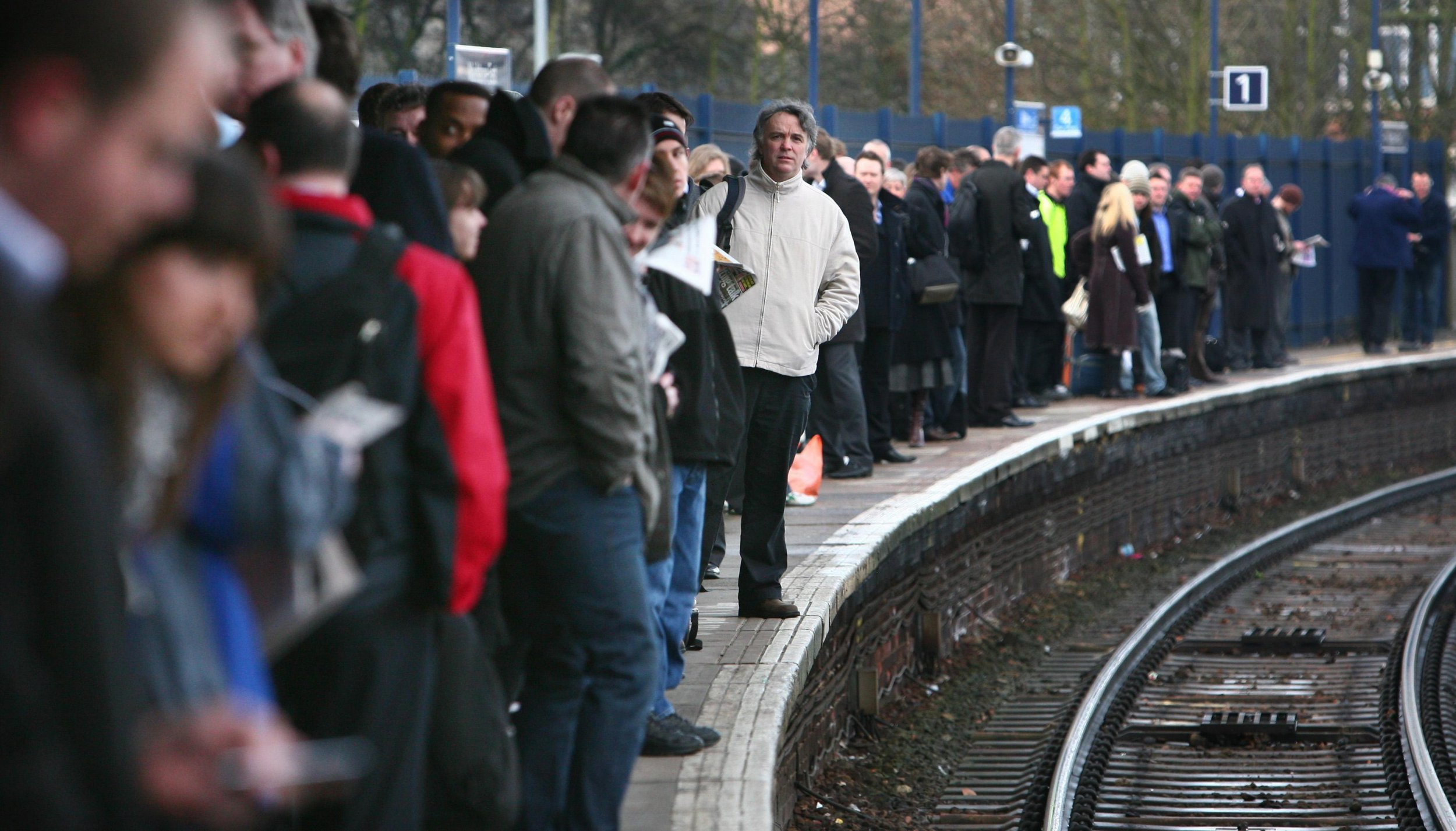 File photo dated 05/03/09 of commuters waiting on a platform as more than one in seven trains were late in the 12 months to the end of September, new figures show. PRESS ASSOCIATION Photo. Issue date: Thursday December 6, 2018. Just 85.9% of trains met the rail industry's punctuality target, the Office of Rail and Road said. See PA story RAIL Punctuality. Photo credit should read: Gareth Fuller/PA Wire