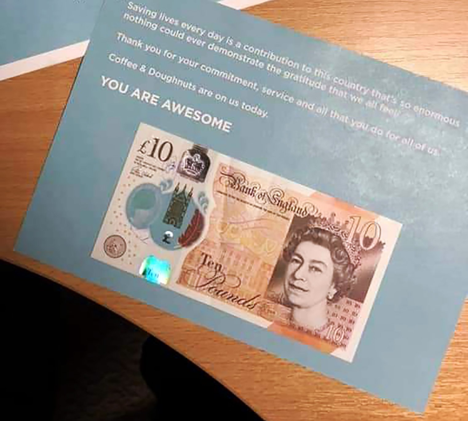 WESSEX NEWS AGENCY Jim Hardy email news@britishnews.co.uk mobile 07501 221880 STORY CATCHLINE: SCROOGE A mystery Santa is pinning tenners to ambulance windscreens...but Scrooge bosses are ordering the 999 mercy call crews to hand over the dosh. Pic shows the note with the tenners