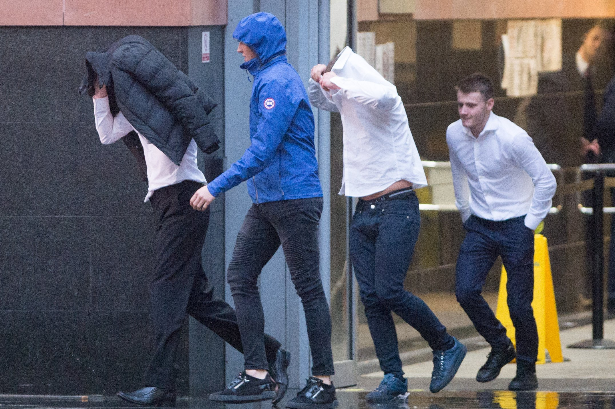 Lewis Hart, Lewis Hall, Jordan Taylor and Elliot Burnie (far right, uncovered) leaving Manchester Magistrates court after recieving 12 month community orders and 40 hours unpaid work for vandalising a first world war tribute in Rochdale. Disclaimer: While Cavendish Press (Manchester) Ltd uses its' best endeavours to establish the copyright and authenticity of all pictures supplied, it accepts no liability for any damage, loss or legal action caused by the use of images supplied. The publication of images is solely at your discretion. For terms and conditions see http://www.cavendish-press.co.uk/pages/terms-and-conditions.aspx