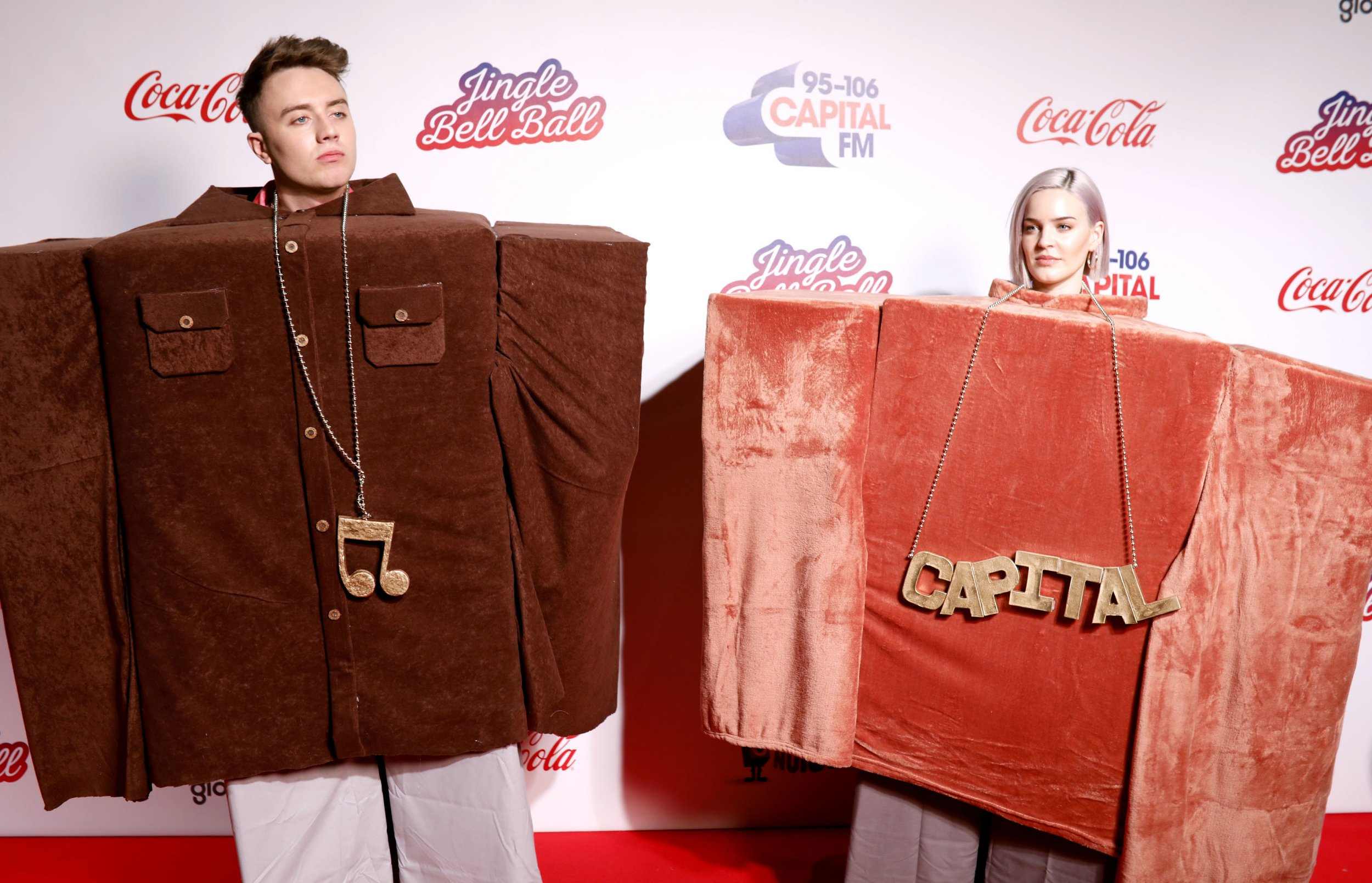 Capital FM Presenter Roman Kemp and Anne-Marie during the media run on day one of Capital's Jingle Bell Ball with Coca-Cola at London's O2 Arena. PRESS ASSOCIATION Photo. Night one of the event saw performances from Liam Payne, Rita Ora, Ellie Goulding and David Guetta. Picture date: Saturday December 8, 2018. See PA story SHOWBIZ Jingle Bell. Photo credit should read: David Parry/PA Wire