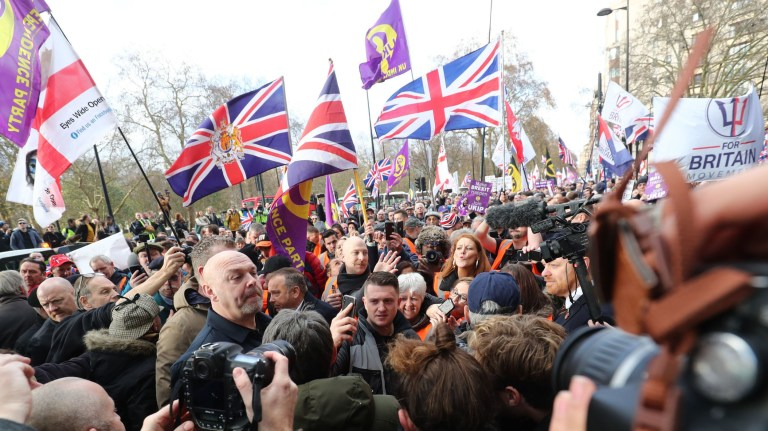 """Tommy Robinson (centre, holding mobile phone) arrives to take part in a """"Brexit Betrayal"""" march and rally organised by Ukip in central London. PRESS ASSOCIATION Photo. Picture date: Sunday December 9, 2018. See PA story POLITICS Brexit March. Photo credit should read: Gareth Fuller/PA Wire"""