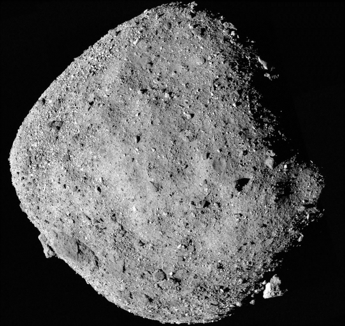 This mosaic image composed of 12 PolyCam images collected on Dec. 2, 2018, and provided by NASA shows the asteroid Bennu. NASA's first look at a tiny asteroid shows the space rock is more moist and studded with boulders than originally thought. Scientists on Monday, Dec. 10, released the first morsels of data collected since their spacecraft Osiris-Rex hooked up last week with the asteroid Bennu, which is only about three blocks wide and weighs about 80 million tons (73 million metric tons). Bennu regularly crosses Earth's orbit and will come perilously close to Earth in about 150 years. (NASA/Goddard/University of Arizona via AP)