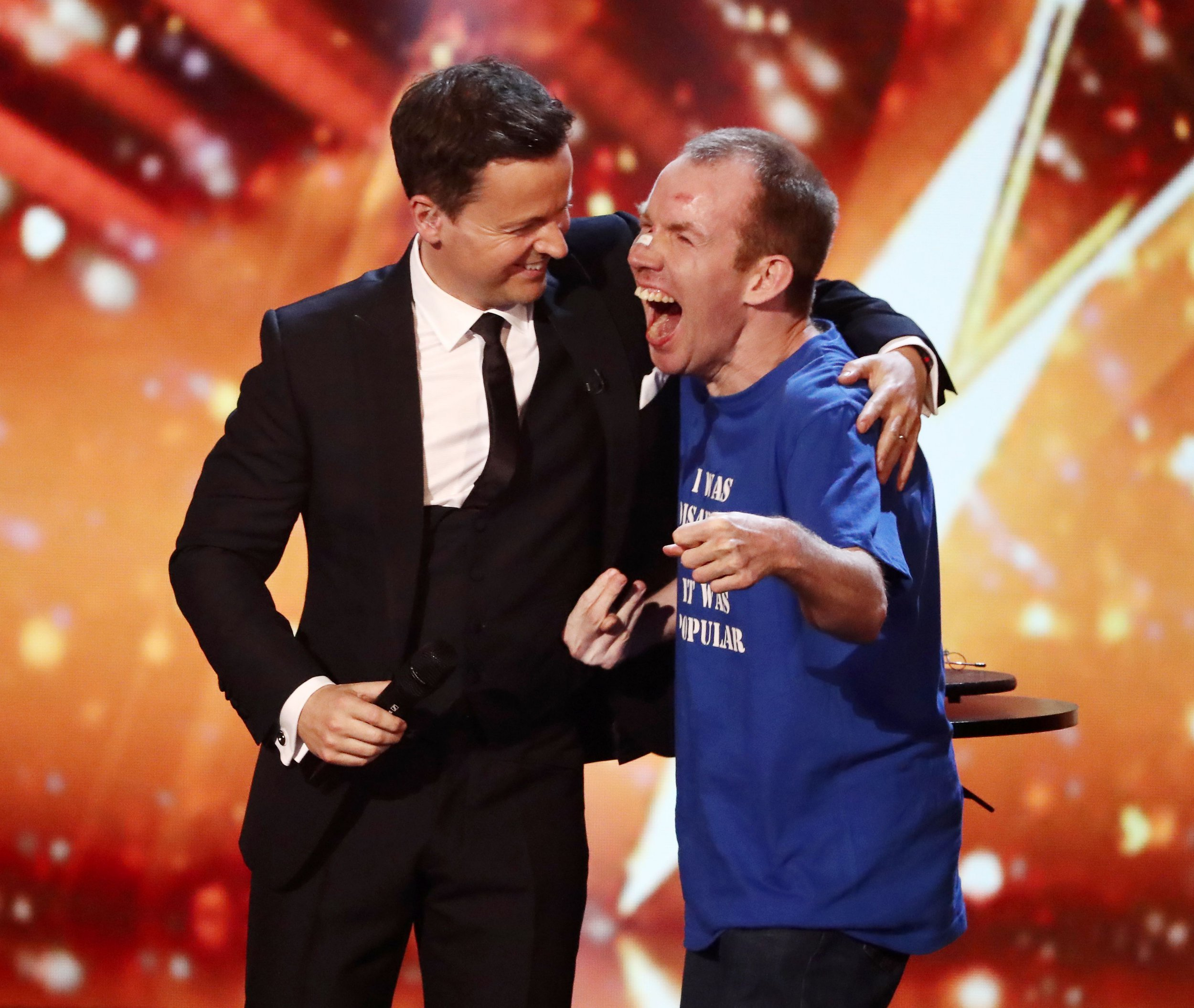 Editorial use only. No book publishing Mandatory Credit: Photo by Dymond/Thames/Syco/REX/Shutterstock (9699621jx) Lost Voice Guy celebrates winning Britain's Got Talent with Declan Donnelly 'Britain's Got Talent' TV show, Series 12, Episode 13, The Final, London, UK - 03 Jun 2018