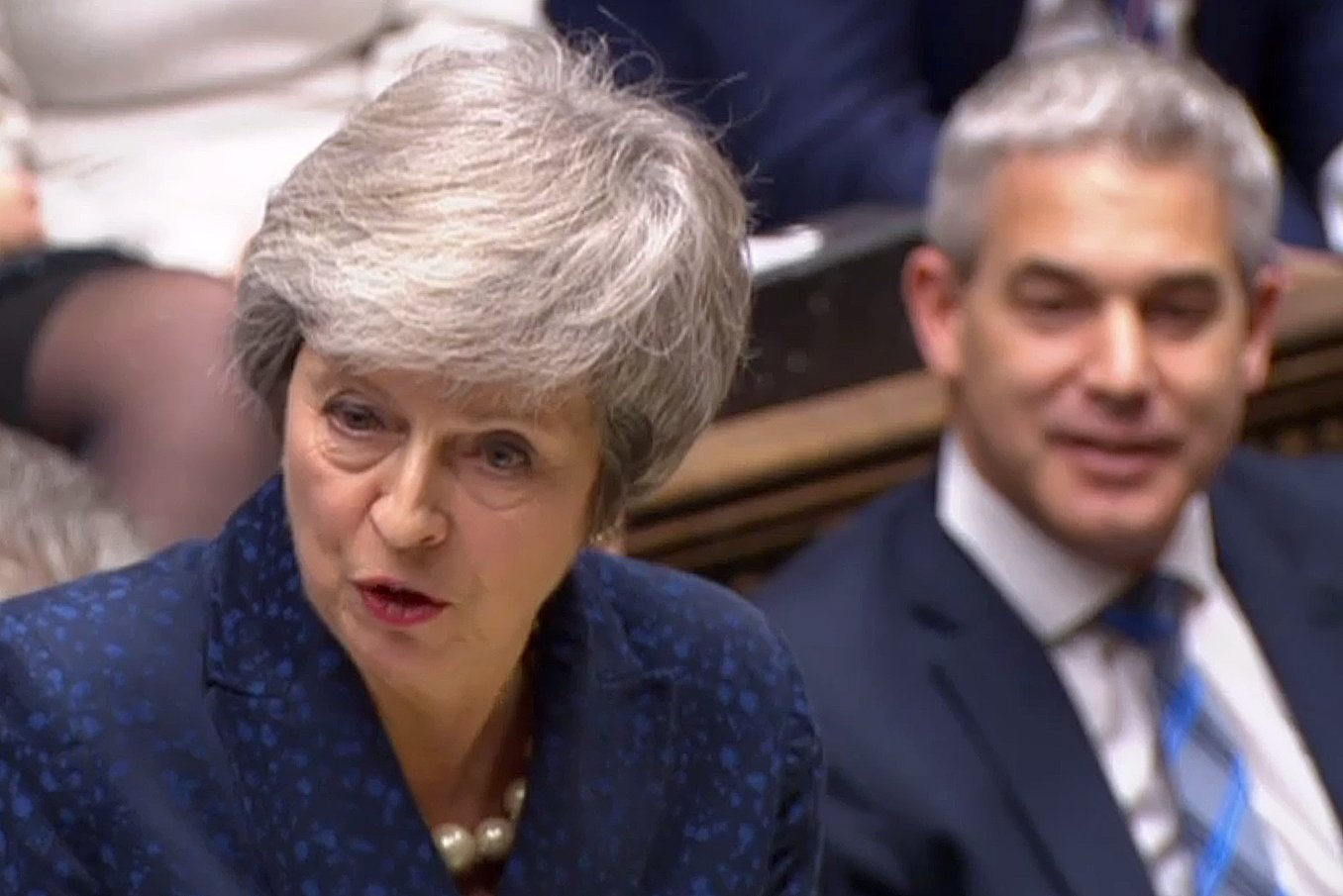 "A video grab from footage broadcast by the UK Parliament's Parliamentary Recording Unit (PRU) shows Britain's Secretary of State for Exiting the European Union (Brexit Minister) Stephen Barclay (R) listen as Britain's Prime Minister Theresa May speaks during the weekly Prime Minister's Questions (PMQs) in the House of Commons in London on December 12, 2017. - Prime Minister Theresa May was on Wednesday to face a vote of no-confidence by MPs in her party over her handling of negotiations with the European Union about Britain's exit from the bloc. May said she will contest a confidence vote in her leadership ""with everything I've got"", adding that changing course now could derail the Brexit process. (Photo by HO / PRU / AFP) / RESTRICTED TO EDITORIAL USE - MANDATORY CREDIT "" AFP PHOTO / PRU "" - NO USE FOR ENTERTAINMENT, SATIRICAL, MARKETING OR ADVERTISING CAMPAIGNSHO/AFP/Getty Images"