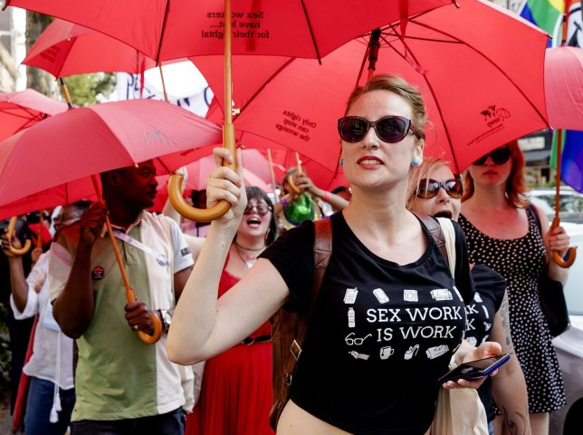 """Sex workers from more than 36 countries demonstrate against legislation around the world that endangers their lives, as a side event of the AIDS2018 conference in Amsterdam on July 24, 2018. - The crowd started the walk at the RAI (where the AIDS2018 conference takes place) and ended in the red light district """"De Wallen"""" in the center of Amsterdam. (Photo by Robin van Lonkhuijsen / ANP / AFP) / Netherlands OUT (Photo credit should read ROBIN VAN LONKHUIJSEN/AFP/Getty Images)"""