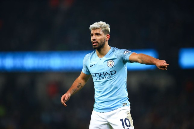 Manchester City striker Sergio Aguero on the pitch in a home kit