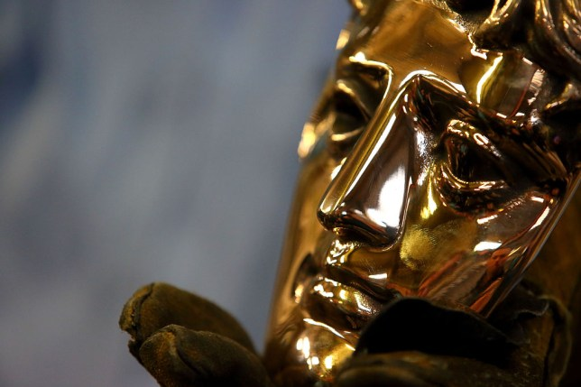 a close up on a bafta award trophy