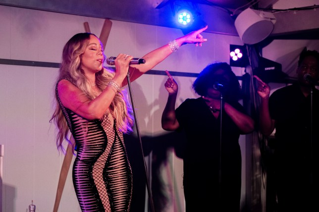 Mariah Carey New Years 2019 Mariah Carey grabs the mic to sing her hits at New Year's party