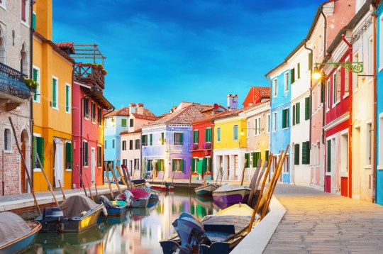 Colorful houses at night in Burano, Venice Italy.