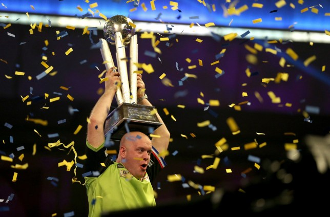 Michael Van Gerwen celebrates with the trophy after winning the final during day sixteen of the William Hill World Darts Championships at Alexandra Palace, London. PRESS ASSOCIATION Photo. Picture date: Tuesday January 1, 2019. Photo credit should read: Steven Paston/PA Wire