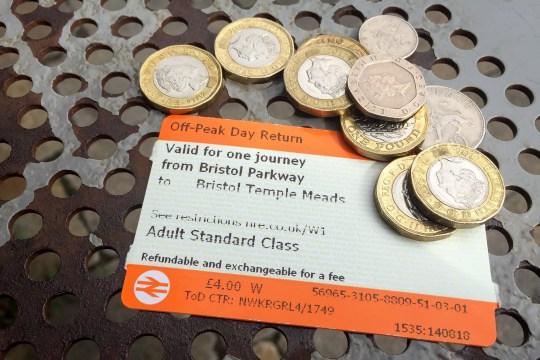 Off-peak day return rail tickets and money.