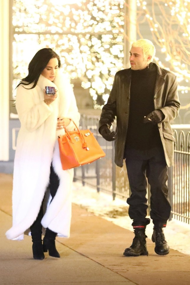 Aspen, CO - *EXCLUSIVE* - *WEB MUST CALL FOR PRICING* Singer Demi Lovato and her boyfriend Henri Levy were spotted enjoying a romantic dinner outing together while on vacation in Aspen, Colorado. Demi was all smiles and certainly has lots to celebrate after closing out a very difficult year. The 26 year old wore a long white fur coat and carried a large Hermes Birkin bag and was wearing what appeared to be new diamond rings on her finger. Pictured: Demi Lovato, Henri Levy BACKGRID USA 2 JANUARY 2019 BYLINE MUST READ: NEMO / BACKGRID USA: +1 310 798 9111 / usasales@backgrid.com UK: +44 208 344 2007 / uksales@backgrid.com *UK Clients - Pictures Containing Children Please Pixelate Face Prior To Publication*