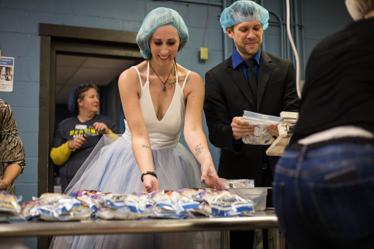 Couple get married at the charity that brought them together and feed hungry children after vows