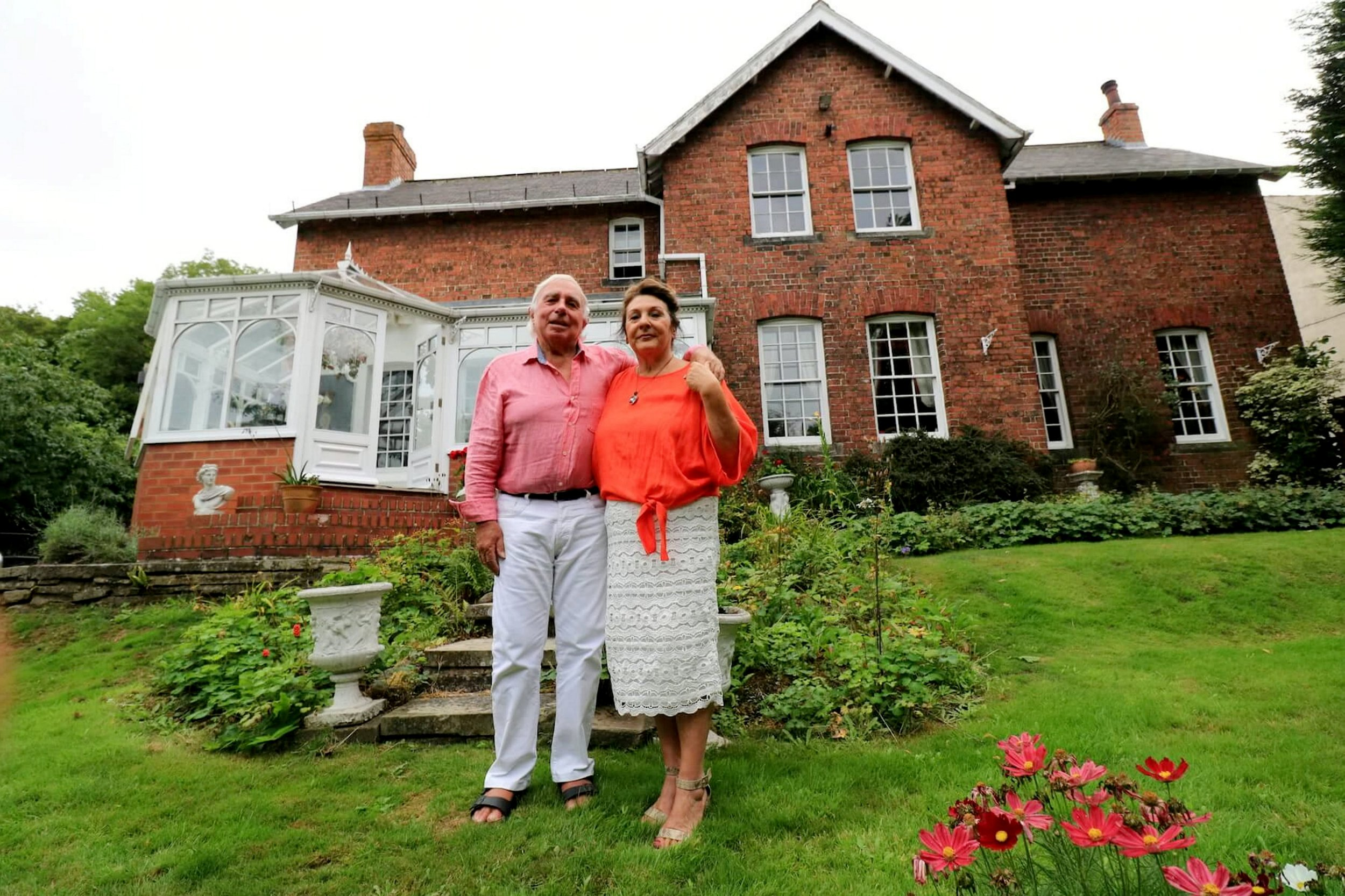 Avril Smith, 68 and Robert Smith, 75, with their house. See SWNS story SWLEhouse; A raffle set up to give people the chance to win the keys to a ?500k home for just ?10 has been dramatically SHUT DOWN by the gambling commission. Owners Robert Smith, 75 and wife Avril Smith, 68, allowed entrants the chance to win their incredible home in North Yorkshire if they bought a ?10 ticket to the draw set up in September 2018. However, in a statement posted on the raffle's website, the couple gave the devastating news the Gambling Commision had closed down the raffle as it had been deemed a potential lottery. The Gambling Commision will not allow the couple to offer the 1875 house as a prize or to offer a cash alternative.