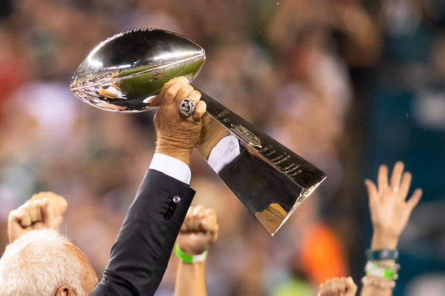 The Super Bowl trophy being raised into the air