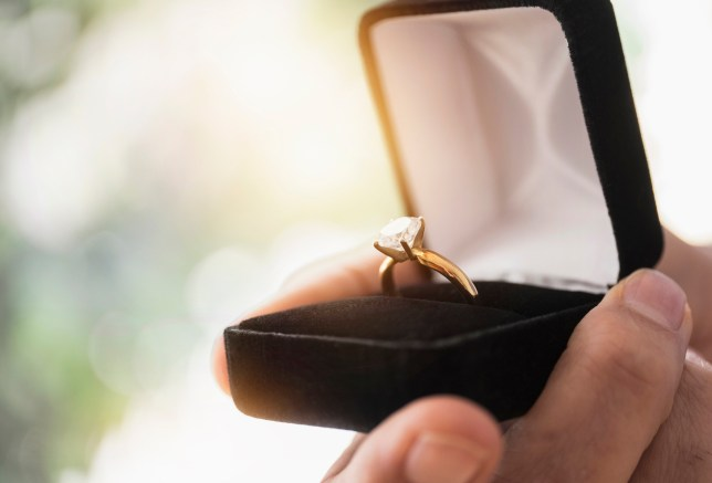 man proposing with ring